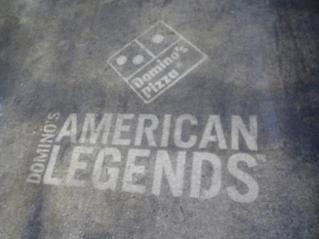 dominos pizza reverse graffiti