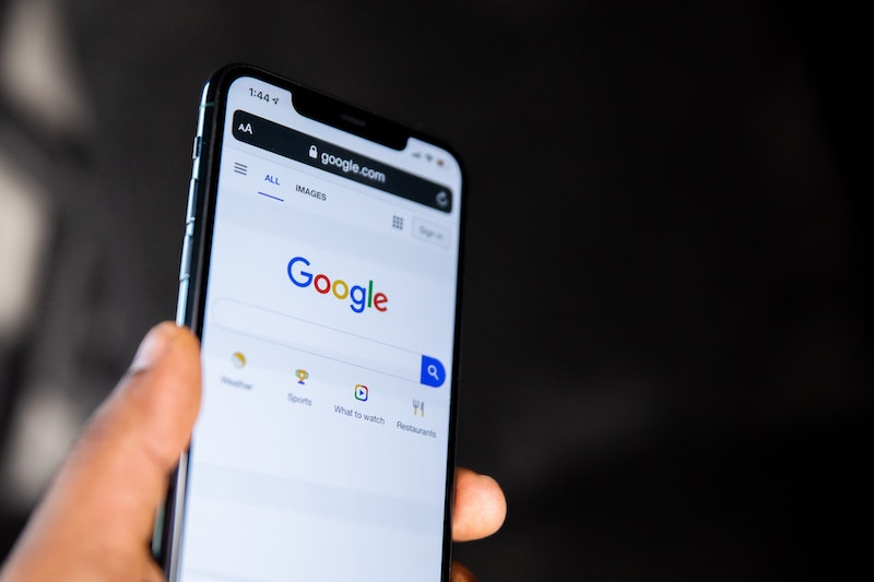 google mobile-first indexing—hand holding iphone