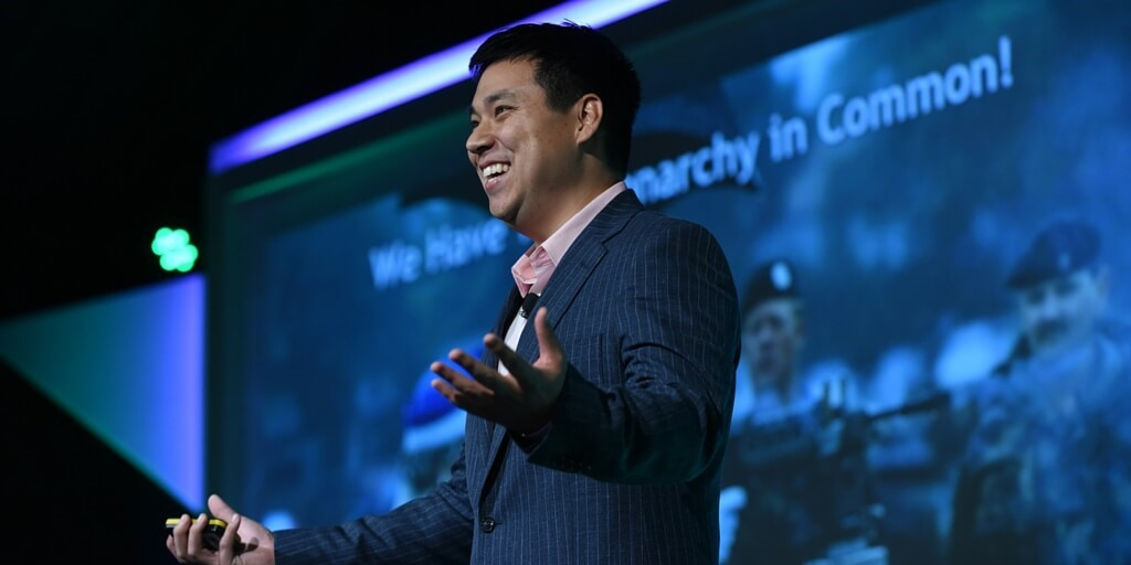 Thought leadership marketing Larry Kim on stage