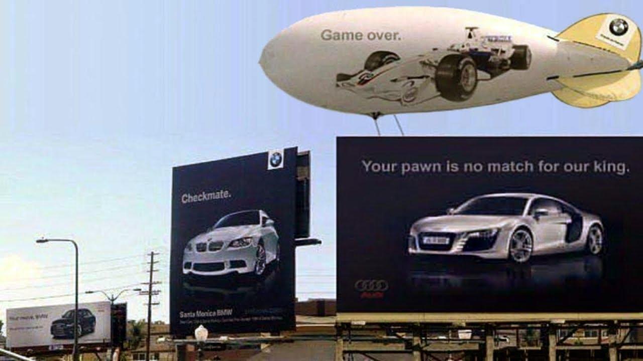 Ambush marketing Audi vs. BMW billboard war blimp game over