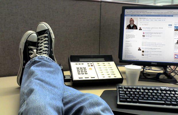 Facebook for work feet up on desk