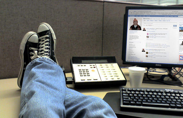 Facebook for work feet up on desk