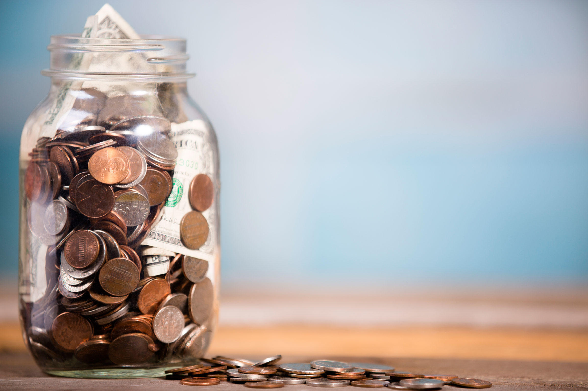 Freelancer's guide to taxes money in a Mason jar