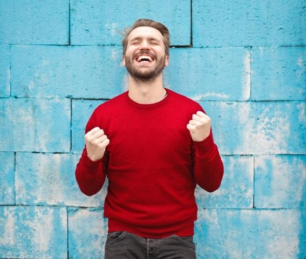 stock photo of guy in front of blue wall