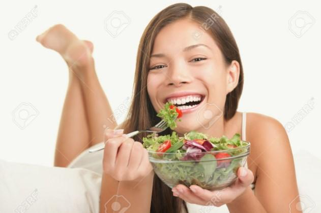 stock photo of woman eating salad