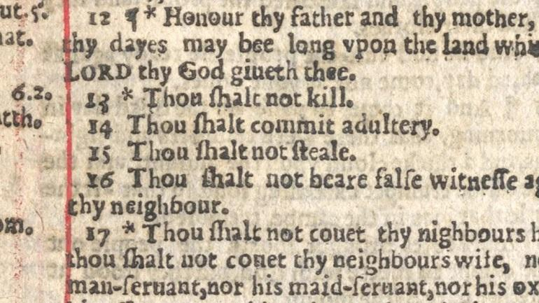 "picture of Bible page with ""Thou shalt commit adultery"""