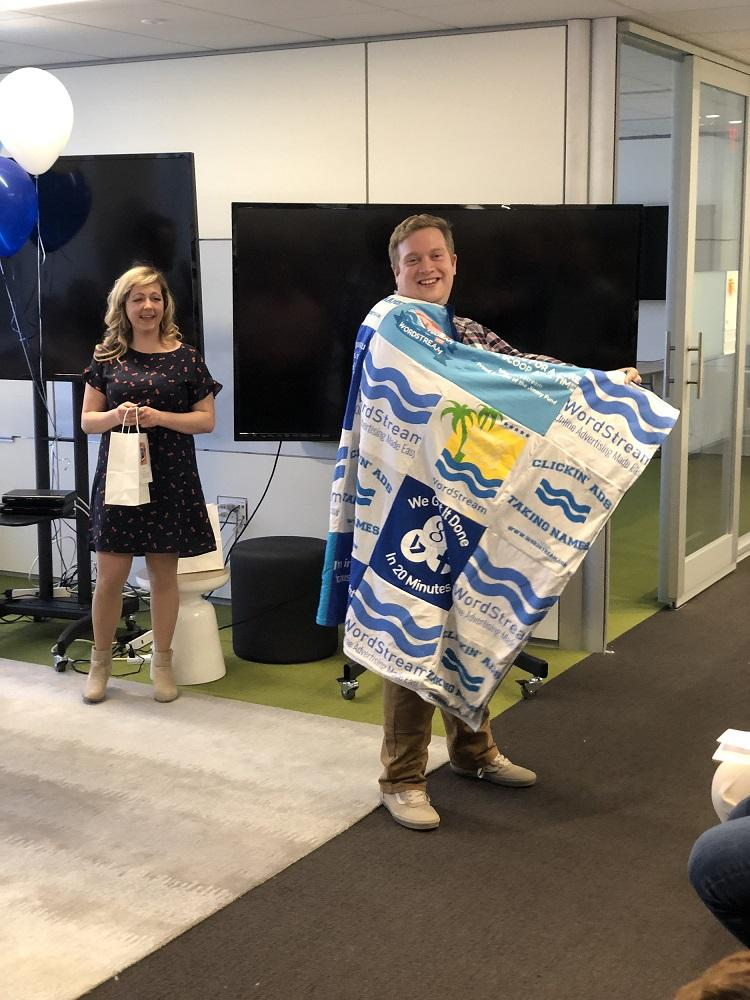 Greg in his raffle prize, a Wordstream blanket