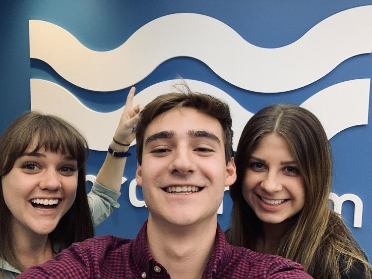 three interns in front of WordStream logo