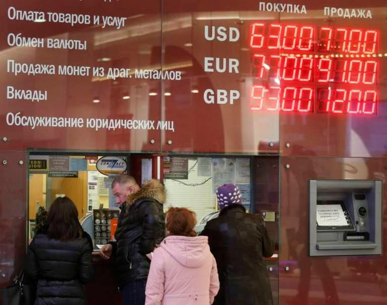 PPC in Russia people queuing outside a currency exchange