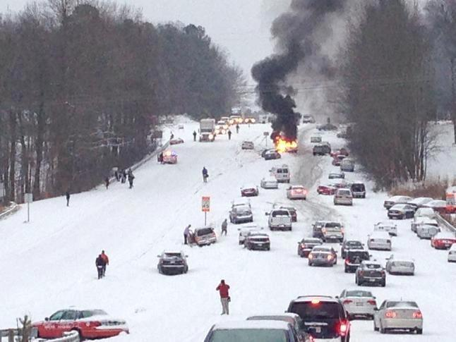 Raleigh NC snow chaos car on fire