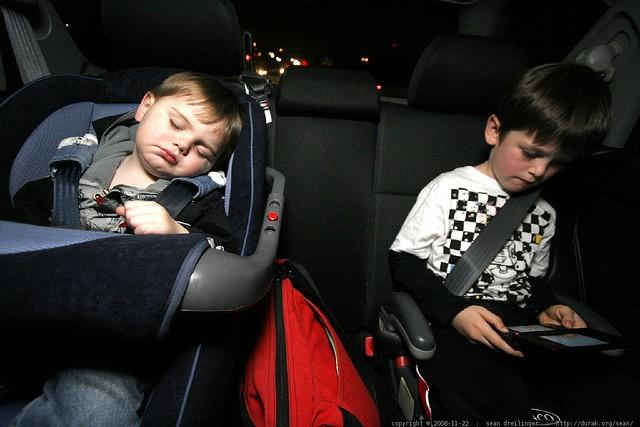 two kids in the car with their seatbelts on