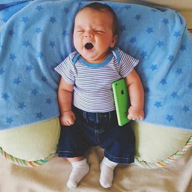 social media marketing plan baby holding iphone