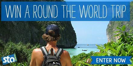 "travel marketing sta display ad with image of backpacker and text saying ""win a round the world trip, enter now"""