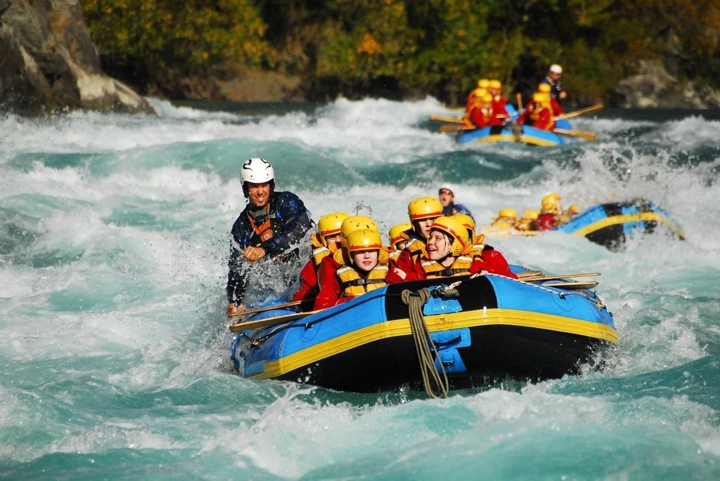 travel marketing image of a group enjoying a white water rafting trip
